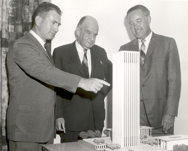 NASA officials examine a model of the Electronics Research Center, which became the Volpe Center when it was transferred from NASA to DOT in the early 1970s.